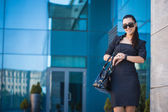 Beautiful woman walking in the city — Stock Photo