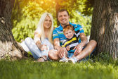 Happy family in the summer park — Stock Photo