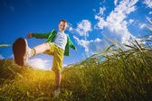 Running little happy boy in the  meadow weat field — Stock Photo