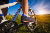 Foot on pedal of bicycle — Stock Photo