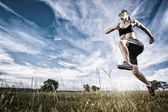 Young woman jogging in nature — Stock Photo