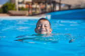 Kid swimming and playing in pool. summertime — Stock Photo