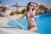 Beautiful, woman in pool — Stock Photo