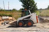 Mini excavator — Stock Photo