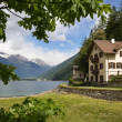 Villa near the lake in Swiss Alps — Stock Photo