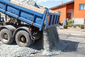 Dumper unload crushed stone — Stock Photo