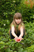 Young girl working in the garden — Stock Photo