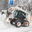 Small excavator bobcat working on the street — Stock Photo