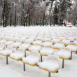 Snow-covered seats — Stockfoto
