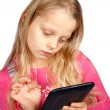 Little girl using ebook reader — Stock Photo