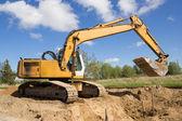 Excavatrice travaillant — Photo