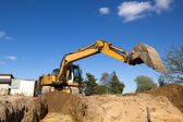 Excavator digging sewer trenche — Stock Photo