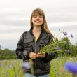 Young girl in cornflower field — Stock Photo #20015287