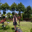 Stock Photo: Boy mowing garden