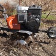 Rototiller in the garden — Stok fotoğraf