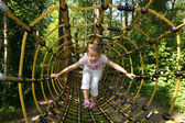 Little girl in outdoor park attractions — Stock Photo