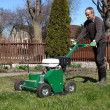 Man working with Lawn Aerator — Zdjęcie stockowe