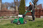 Man working with Lawn Aerator — Stock Photo