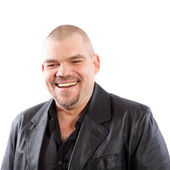 Smiling man in black leather jacket — Stock Photo