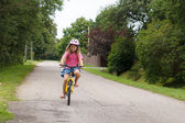 Girl rides a bicycle — Stock Photo