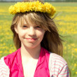 Young girl with dandelion wreath — Stock Photo
