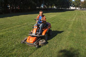 Ride-on lawn mower cutting grass. — Stock Photo