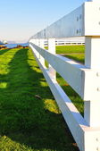 White fence receding into the distance — Stock Photo