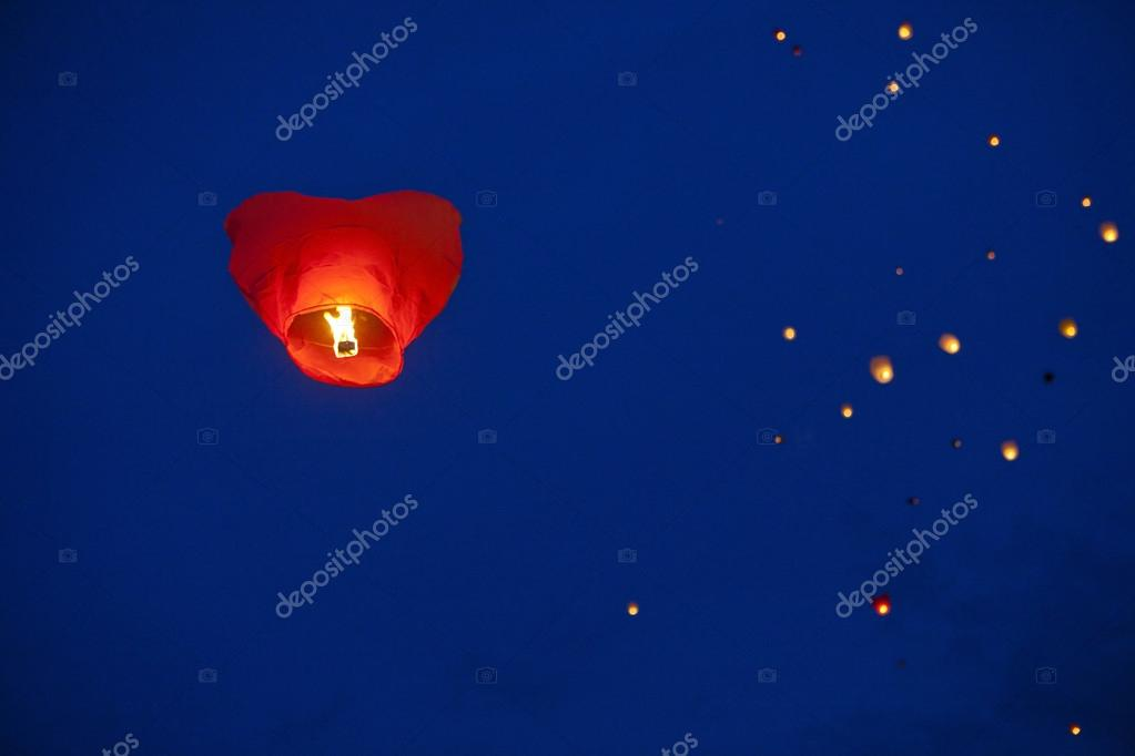 Red heart-shaped chinese lantern in the night sky  Stock Photo #17651667