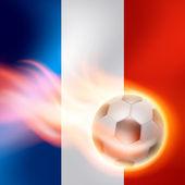 Burning football on France flag background — Stock vektor