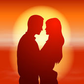 Sea sunset with silhouette couple. — Stock Vector
