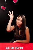 Young woman throw playing cards — Stock Photo