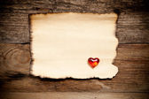 Horizontal old paper on wooden background — Stock fotografie