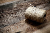 Rope coil on old wooden background — ストック写真