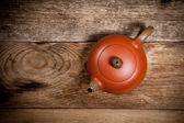 Teapot on old wooden table — Stock fotografie