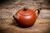 Teapot on old wooden table — Photo