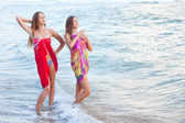 Two young women in a pareo on the sea — Photo