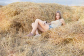 Beauty woman in the straw in field — Photo