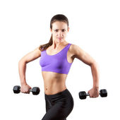 Sporty muscular woman with two dumbbells — Stok fotoğraf