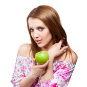 Woman with green apple on white background — Stock Photo