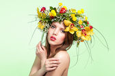 Beautiful woman with flower wreath — Stock Photo