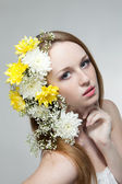 Young woman with flowers in a hair — Stock Photo
