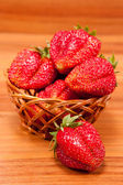 Strawberries in a small pottle on wooden table — Stock Photo