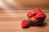 Fresh strawberries in a small pottle — Stock Photo