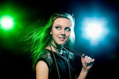 Clubber dancing and looking sideways with smile — Stock Photo