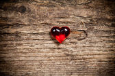 Red heart on old wooden table — Stock Photo