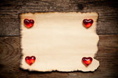 Horizontal old paper on wooden background — Stock Photo