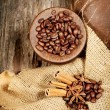 Cinnamon, star anise and coffee beans on old wooden table — Stock Photo #43350921