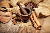 Cinnamon, star anise and coffee beans on old wooden table — Stock Photo