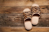 Slippers on wooden floor — Stock Photo
