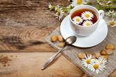 Herbal tea with chamomile on old wooden table — 图库照片